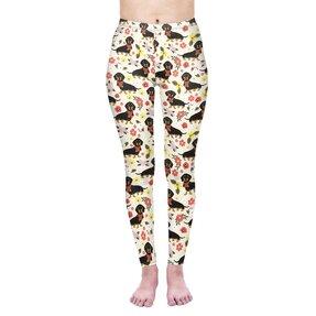 Damskie elastyczne legginsy Jamnik i kwiaty