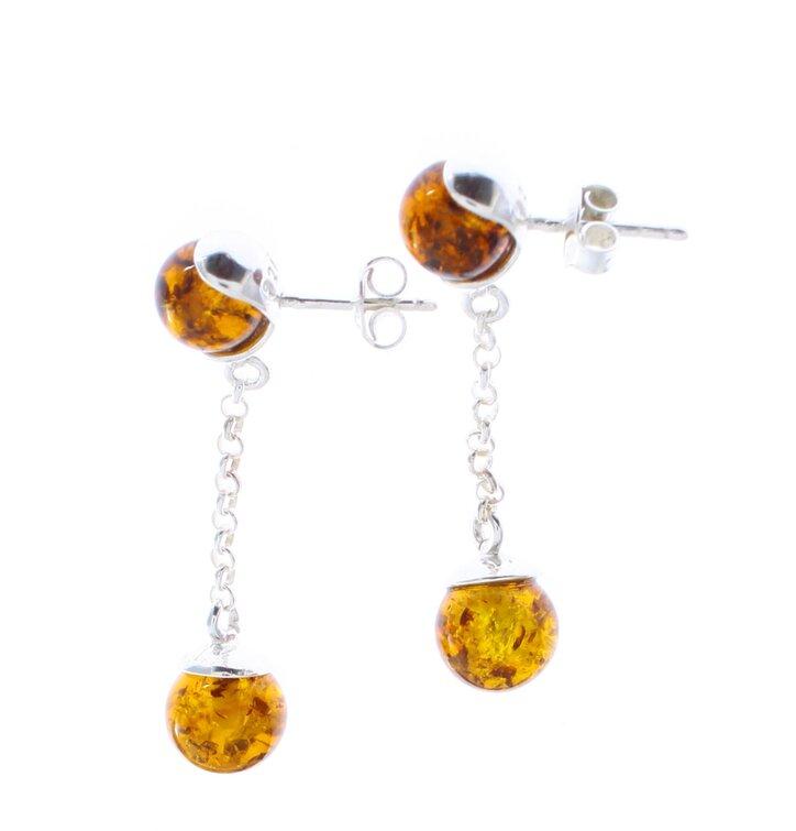 Silberne hängende Ohrringe mit Bernstein Gleichgewicht