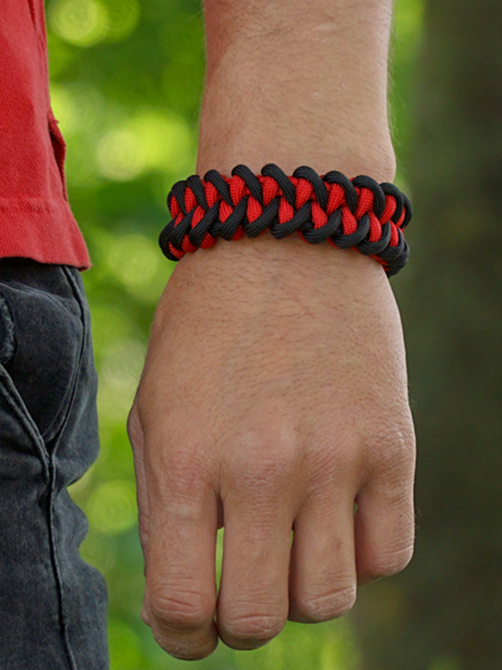 Looking for an original and unusual gift? The gifted person will surely surprise with Black & Red Paracord Bracelet SharkWith Fire Starter, Compass and Whistle