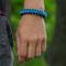 Zľava Bracelet en paracorde bleu Skip avec boucle ajustable